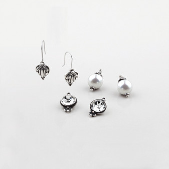 Set of three burnished silver, classic Swarovski® crystal and white shell pearl french wire earrings