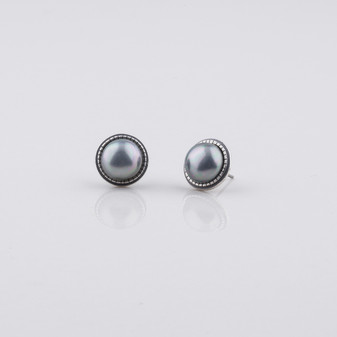 Grey shell pearl stud earrings with detailed edge