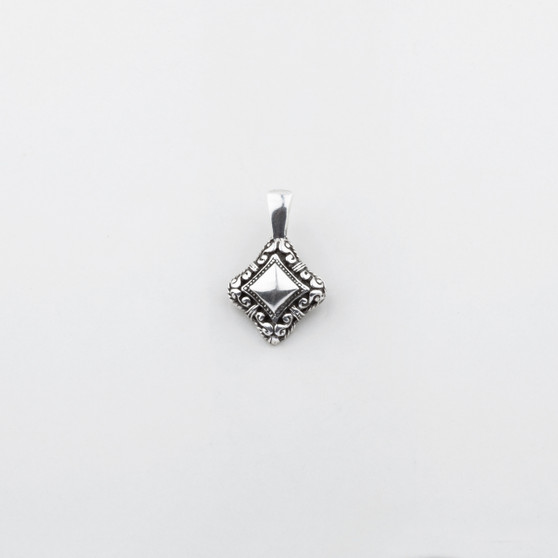 Petite burnished silver pendant with intricate filigree.