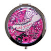 Pink, Girly, Vegas cards, dice, poker chips, etc as a background on this round compact mirror.