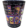 Ceramic Black Las Vegas shotglass showing different views of the city inside the giant Las Vegas font on the front.
