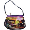 Small purse with fun zipper (shaped like the Las Vegas Welcome Sign) has a pretty Sunset Hue color and Las Vegas casinos on it.
