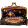 Metal snap closure on this black plastic Las Vegas Coin purse with a Vegas Sign and colorful stars on the print.