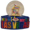 Acrylic base and a Glass Snowglobe. Base is Blue with Glittery Las Vegas in different colors on it. Inside the snowglobe has glitter snow and colorful 3D versions of the Las Vegas Casinos that you know and love.
