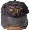 Denim Baseball style cap with Las Vegas on the front. The bill has a pop of rust color on it.