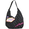 Super Handbag style LV purse that is black, has Las Vegas in tiny gray print all over it with an overlay large Pink Las Vegas font and finally a Large Welcome to Las Vegas Sign in toward one side.