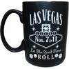 Black ceramic Las Vegas souvenir mug with a Gray design on both sides, left view.