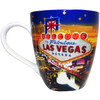 Oversized Las Vegas ceramic coffee mug with a prominent Las Vegas Sign design and a hotel Glittery Star collage in the background, side view.