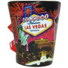Ceramic black Las Vegas Fireworks shotglass showing the famous Casinos with Fireworks bursting in the background.