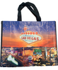 Purple and Orange Hues background tote bag shows the natural beautiful night skyline over Las Vegas Casinos in bright colors.