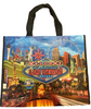 Blue background tote bag shows a Bright Neon Las Vegas Welcome sign over Las Vegas Casinos in bright colors.