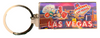 Metal Rectangle Las Vegas themed keychain with Casinos and Gaming Icons in the background.