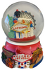 Acrylic base and a Glass Snowglobe. Base is Pink with colorful icons. Inside the snowglobe has glitter snow and colorful 3D versions of the Las Vegas Casinos that you know and love.
