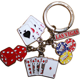 Las Vegas Keychain with dangling metal charms of dice, poker chips, full house cards, and 4 aces... and of course Las Vegas.