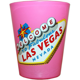 PINK Glass Las Vegas shotglass with a design on the front which has a Colorful Version of the Las Vegas Welcome Sign.