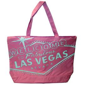 Pink canvas totebag has a Silver printing of the Famous Welcome To Las Vegas Sign on it.