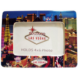 Blue Background on this colorful view of the Las Vegas Strip scene that surrounds the edges of this ceramic photo frame.