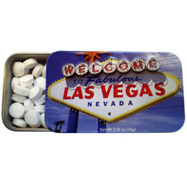Tin rectangle slide open box of white mints. Design on Tin is blue sky with the Las Vegas sign prominent in the middle.
