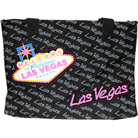 Canvas Totebag that is black, has Las Vegas in tiny gray print all over it with an overlay large Pink Las Vegas font and finally a Large Welcome to Las Vegas Sign in toward one side.