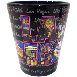 Ceramic Black Las Vegas shotglass showing different views of the city inside the giant Las Vegas font on the front.