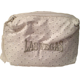 White Cosmetic Purse with shiny specks all over it and a large Silver embroidered Las Vegas on the front, white tassel pull zipper.