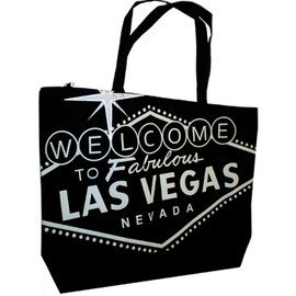 Black canvas totebag has a Silver printing of the Famous Welcome To Las Vegas Sign on it.