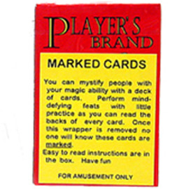 Red and yellow box of playing cards with a warning that these cards are to be used for tricks and gags.... inside cards appear to be a normal deck.