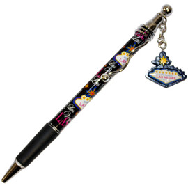 Black design pen with  Las Vegas written all over it.  There is a small dangle charm that hangs from the top. Charm is shaped like the Las Vegas Welcome Sign.