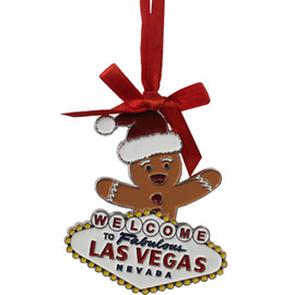 Metal Las Vegas Gingerbread Man Shape ornament that also has the Las Vegas Welcome Sign; with a Red Ribbon.
