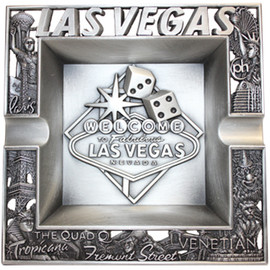 Metal square Las Vegas ashtray with raised design in the middle, cutout design on it's edges, and great detail in this.