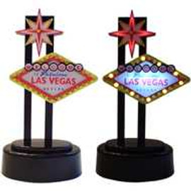 Black base holds a Minim Replica of the Welcome to Las Vegas Sign. This lights up and flashes like the real sign does.