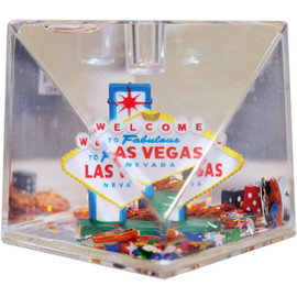 Clear cube with a cut out corner, snow globe liquid with cute Vegas Iconic items like the colorful Las Vegas Sign, mini dice, mini poker chips, etc.