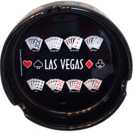 Black ceramic ashtray that has graphic of repeating winning poker hands and Las Vegas in the middle.