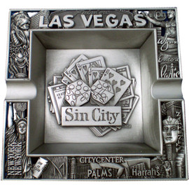 Metal square Sin City Las Vegas ashtray with raised dice design in the middle, cutout design on it's edges, and great detail in this.