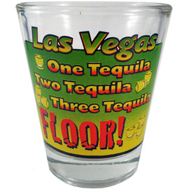 Glass Las Vegas shotglass with a Green, Yellow, and Red design on the front which says Las Vegas One Tequila, Two Tequila, Three Tequila, FLOOR!