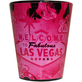 Ceramic Pink Vintage Vegas shotglass showing muted tones of pink on a black background design with older iconic Vegas images.