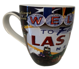 Oversized Las Vegas ceramic coffee mug with a Las Vegas Sign and Patriotic Flag collage design on a vibrant strip background, side view.