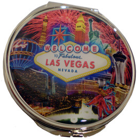 Bright colorful Fireworks bursting design with Las Vegas Casinos in the background on the cover of this compact mirror.