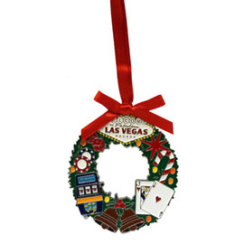 Metal Las Vegas Round Wreath Shape ornament that also has the Las Vegas Welcome Sign; with a Red Ribbon.