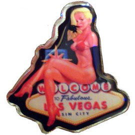 Sexy Las Vegas Blond sitting on the Welcome to Vegas Sign.