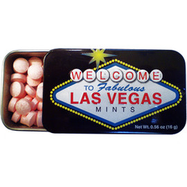 Tin rectangle slide open box of red cinnamon mints. Design on Tin is black background with the Las Vegas sign prominent in the middle.