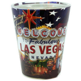 Glass Las Vegas shotglass with a full body US Flag wrap background, front view.