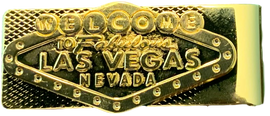 Gold tone color money clip with Las Vegas Sign on it.