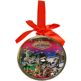 Round Metal Las Vegas ornament with a Red Ribbon and LV Pink Skies Design in the Center- front side.