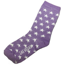 kid sized crazy las vegas souvenir socks with stars and purple background