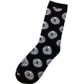crazy socks from las vegas with gray poker chips on them on black socks