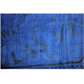 Las Vegas Beach Towel in Blue with Las Vegas Sign muted in Gray, closeup of design
