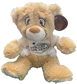 Tan colored Las Vegas Bear with a light colored souvenir hoodie.