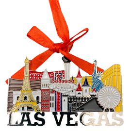 Metal Las Vegas City Cut Out Shape ornament that also has the Las Vegas Welcome Sign; with a Red Ribbon.