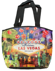 Slightly Rounded Totebag with black straps has Dice on the design bursting out from the Welcome to Las Vegas Sign. Casinos are in the background.